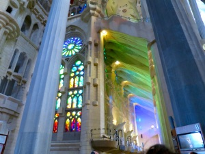 Stain-glass windows illuminating the interior of the cathedral