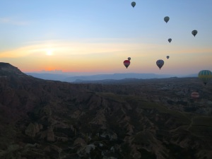 Sun and balloons rising